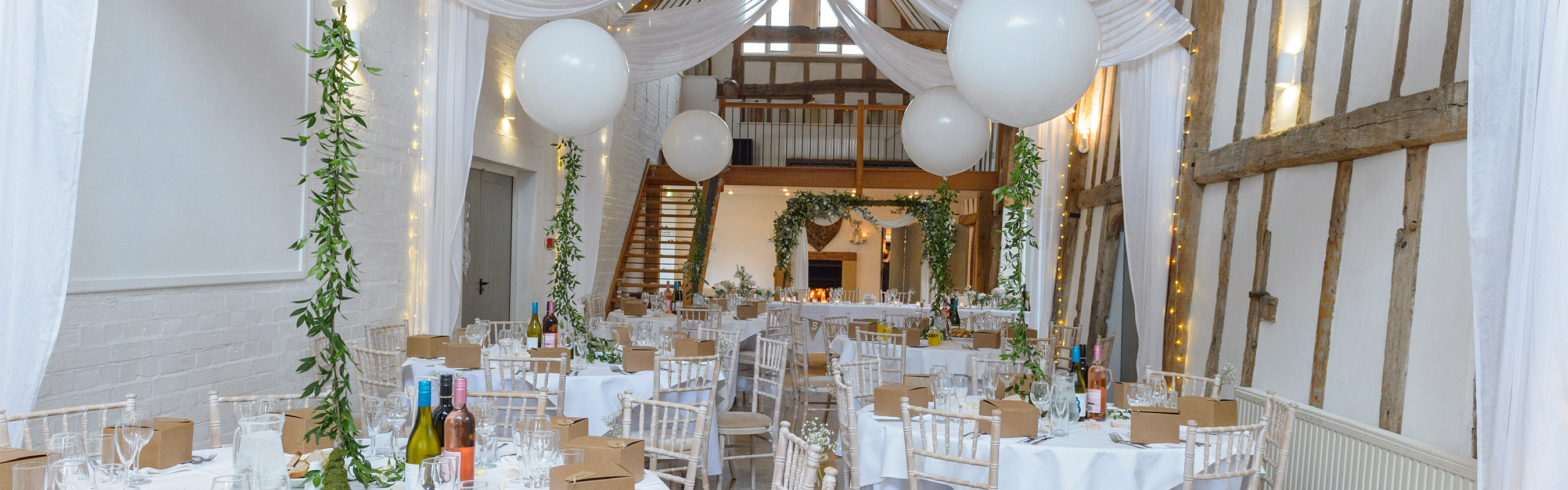 Wedding Breakfast At Dove Barn Wedding Venue decorated in White